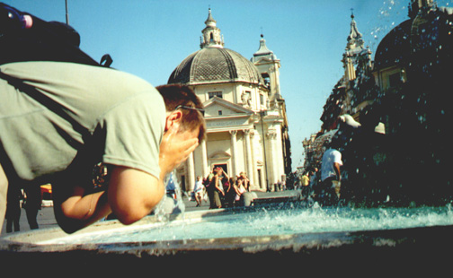Brian Kleinman cooling off in Piazza Popolo. At the beginning of the trip we thought we would never touch the fountain water, mainly because we saw a man pee in one. But Rome was hot.