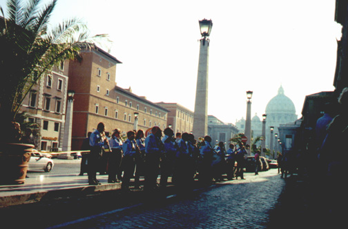 A band playing in front of Basilica di San Pietro.