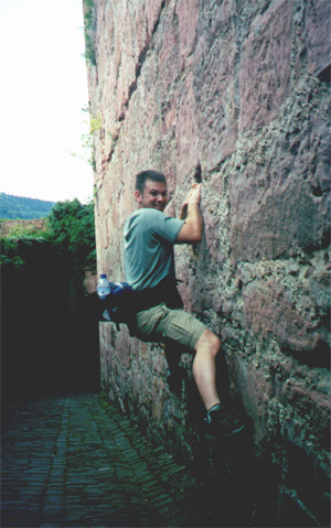 Brian Kleinman climbing on the castle wall.