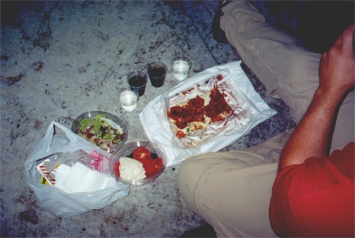 Our dinner at the steps of the duomo: pizza, salads, and wine