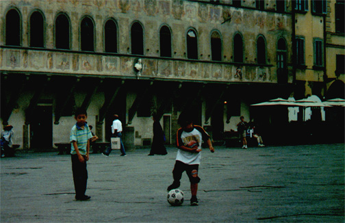 Kids playing in Piazza Santa Croce