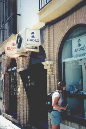 August 4, 2001: Katie Miller looking at the Lladro figurines