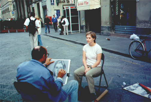 Katie Miller getting her portrait drawn next to the duomo