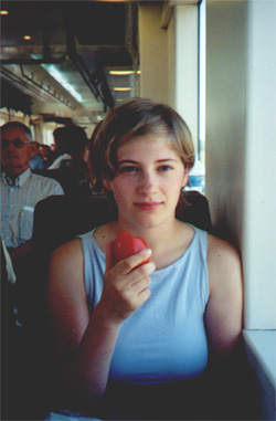 July 27, 2001: Katie Miller eating a tomato on the train to Barcelona
