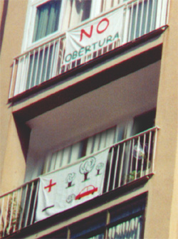 Environmental protest signs hung from apartment buildings in Barcelona